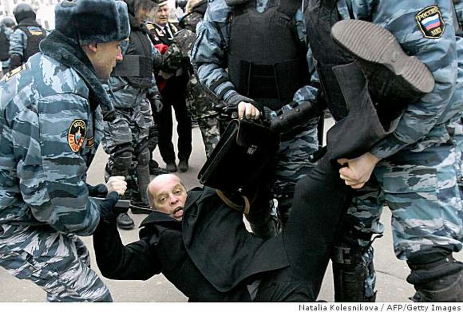 "Russian police forces arrest a demonstrator during an opposition rally called ""Dissenter's March"" in the centre of Moscow on December 14, 2008. Russian police on Sunday detained dozens of people at an unsanctioned opposition rally organised by Kremlin critic and former world chess champion Garry Kasparov, an AFP journalist said. AFP PHOTO / NATALIA KOLESNIKOVA (Photo credit should read NATALIA KOLESNIKOVA/AFP/Getty Images) Photo: Natalia Kolesnikova, AFP/Getty Images"