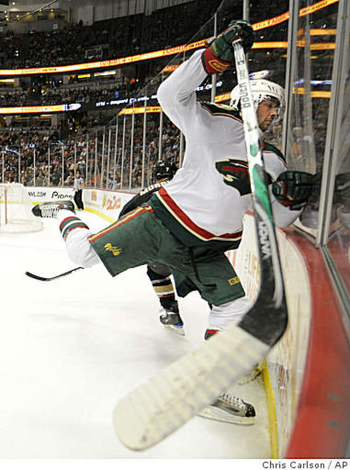 Minnesota Wild left wing Benoit Pouliot is checked into the glass by Anaheim Ducks center Brendan Morrison in the second period of an NHL hockey game in Anaheim, Calif., Sunday, Dec. 14, 2008. (AP Photo/Chris Carlson) Photo: Chris Carlson, AP