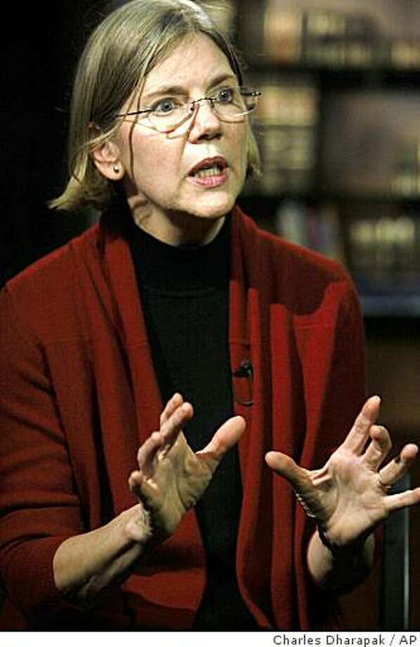 Elizabeth Warren, who chairs an oversight committee set up by Congress to oversee the bailout, is interviewed by the Associated Press in Washington, Thursday, Dec. 18, 2008. (AP Photo/Charles Dharapak) Photo: Charles Dharapak, AP