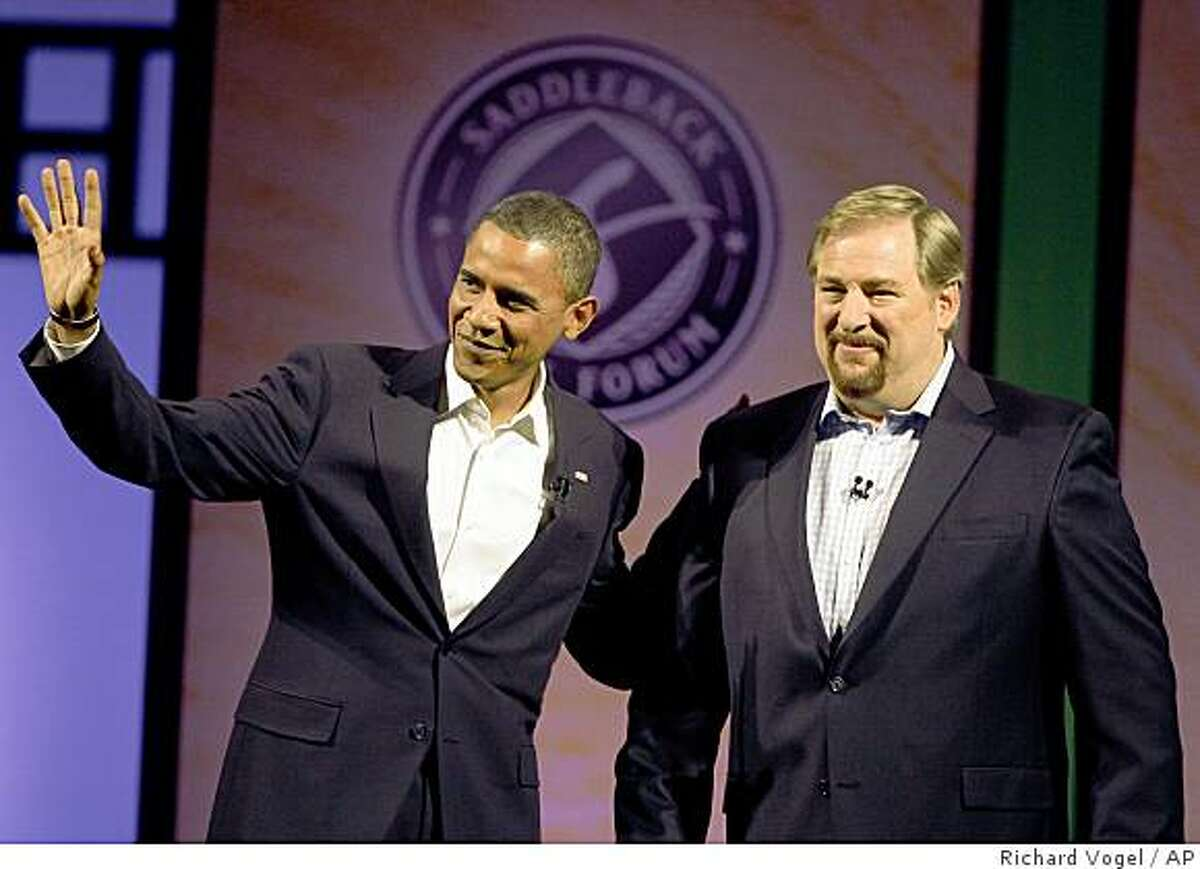 ** FILE ** In this Aug. 16, 2008 file photo, then Democratic presidential candidate, Sen. Barack Obama, D-Ill., left, joins Pastor Rick Warren of Saddleback Church, for a discussion on moral issues. Aretha Franklin will sing, Warren will pray and more than 11,000 U.S. troops will be watching over the ceremonies in case of a terrorist attack during President-elect Barack Obama's Inauguration. (AP Photo/Richard Vogel, File)