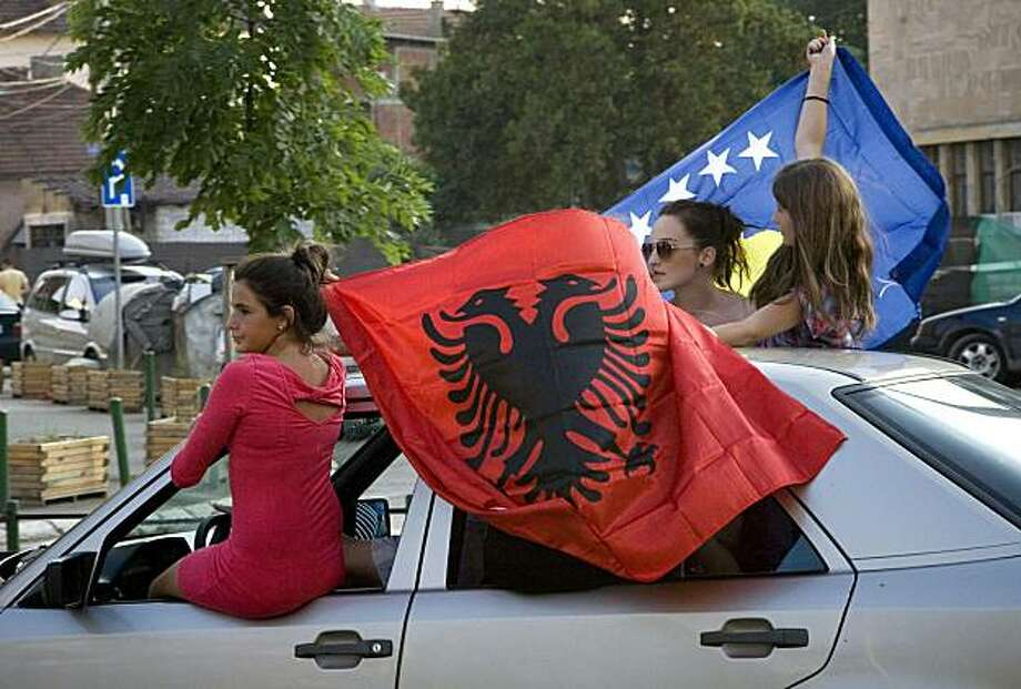 Kosovo Albanians celebrate with flags in the southern part of the divided Kosovo town of Mitrovica on July 22, 2010 following the ICJ ruling on the legality of Kosovo's independence. Kosovo's 2008 declaration of independence, contested by Serbia, did notviolate general international law, the UN's highest court said today. Photo: Laura Boushnak, AFP/Getty Images