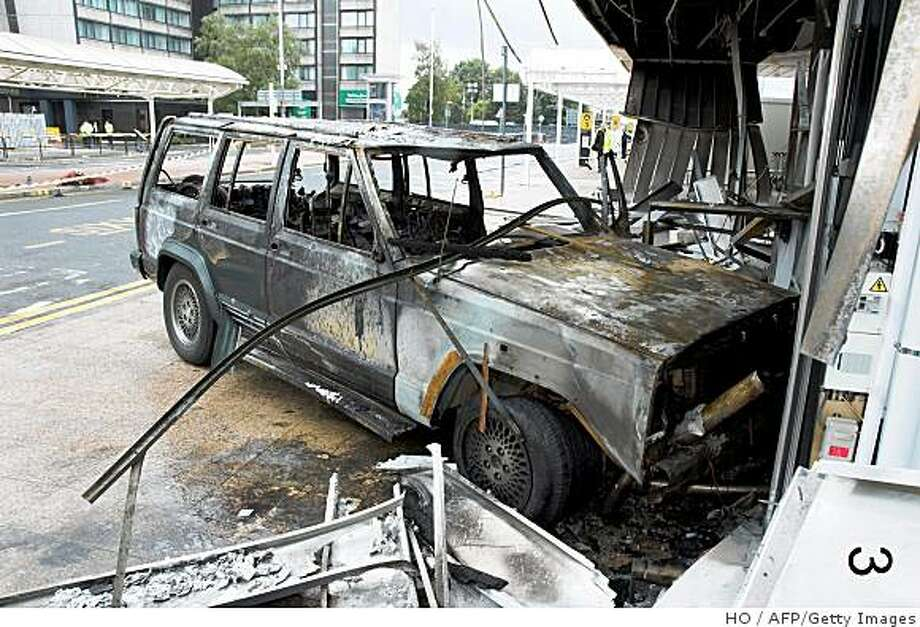 A handout image obtained from the Metropolitan Police on December 16, 2008 shows a vehicle that was driven into a passenger terminal at Glasgow Airport on June 30, 2007. An Iraqi doctor was found guilty Tuesday by a court in London of trying to murder hundreds of people in failed attacks on London and Glasgow last year. Bilal Abdulla, 29, was also found guilty of conspiracy to cause explosions, while his co-defendant Mohammed Asha, a 28-year-old Jordanian neurologist, was found not guilty of both offences. AFP PHOTO/Metropolitan Police/HANDOUT     NO SALES (Photo credit should read HO/AFP/Getty Images) Photo: HO, AFP/Getty Images