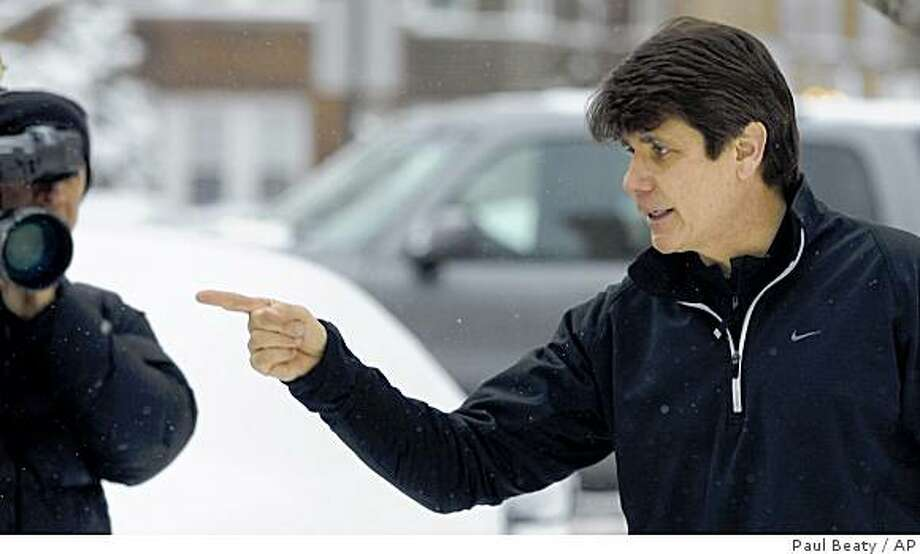 Illinois Gov. Rod Blagojevich talks to the media at  his home before jogging in Chicago, Wednesday, Dec. 17, 2008. Blagojevich said Wednesday he is ready to tell his side of the political scandal to the people of Illinois and that he would do so no later than Thursday. (AP Photo/Paul Beaty) Photo: Paul Beaty, AP