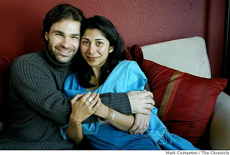 Randy Nasson, left , and Ayesha Mattu pose in San Francisco, Calif. on Wednesday, December 3, 2008. Photo: Mark Costantini, The Chronicle
