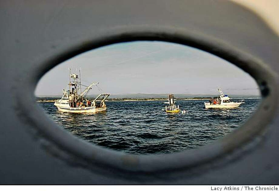 Researchers from Stanford Research Institute show members of the media their new twist on generating electricity from the bobbing of the ocean wave through a buoy, Monday Dec. 8, 2008, in Santa Cruz, Calif. These buoy is located one mile outside the Santa Cruz Harbor. Photo: Lacy Atkins, The Chronicle