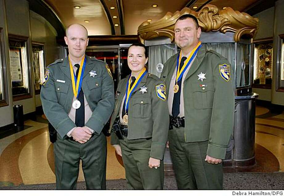 Josh Brennan (left), Liz Gregory and Wilbur Brown were awarded the Medal of Valor by Gov. Schwarzenegger after acting heroically when they had life-and-death encounters in their duties as DFG game wardens. Photo: Debra Hamilton/DFG