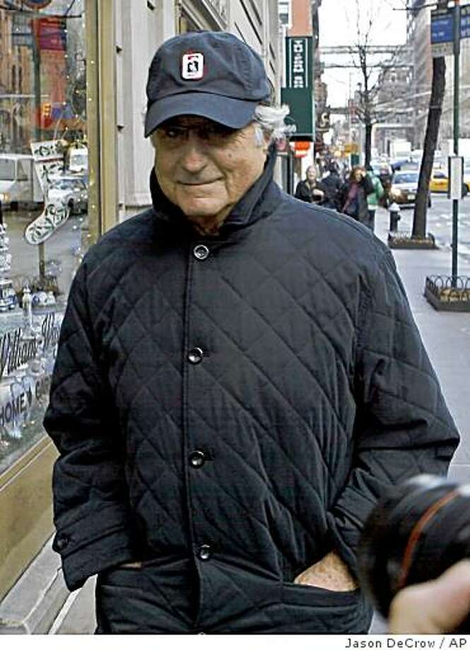 ** RE-TRANS WITH ALTERNATE CROP ** Bernard Madoff, chairman of Madoff Investment Securities, returns to his Manhattan apartment after making a court appearance Wednesday, Dec. 17, 2008 in New York.  The judge in Madoff's fraud case has set new conditions for his bail, including a curfew and ankle-monitoring bracelet for the disgraced investor.  (AP Photo/Jason DeCrow) Photo: Jason DeCrow, AP