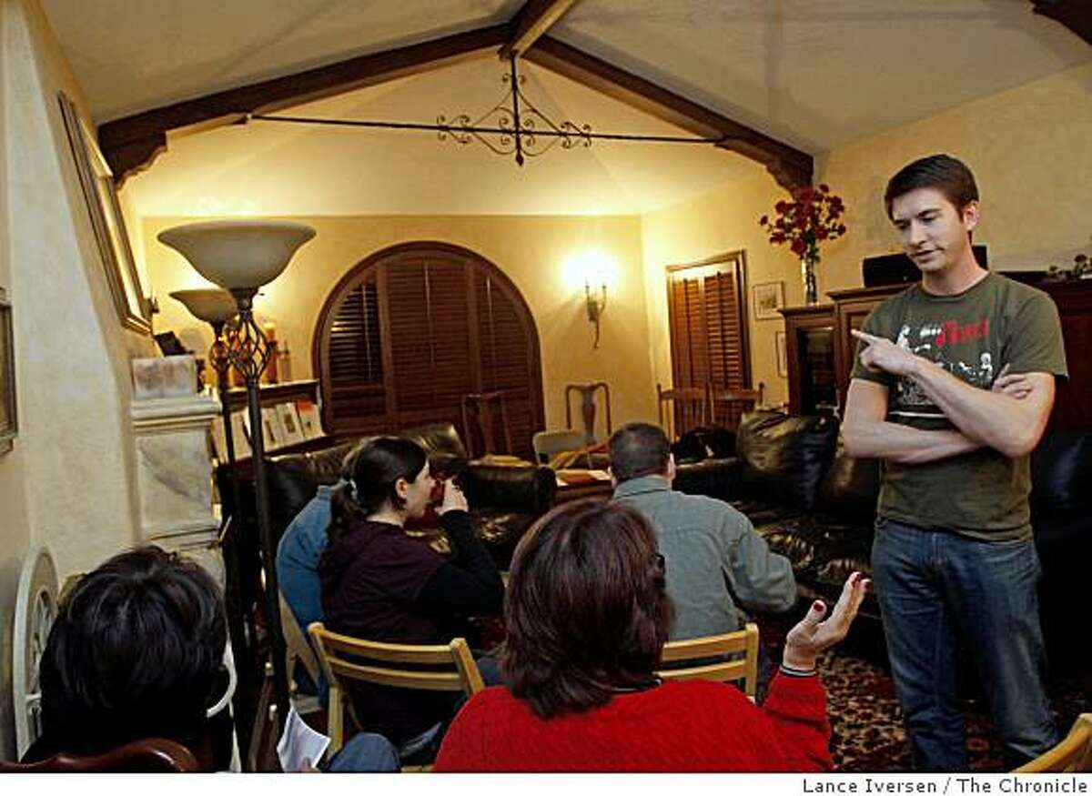 Peter Matthews one of Boxcar theaters two directors chats with members of the audience seated in his mothers living room Mary Matthews. Boxcar Theatre travels around the Bay Area performing in private homes. This night they performed