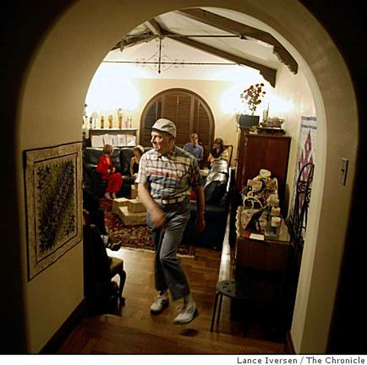 Boxcar Theatre actor Donald Currie exits the living room stage during the companies performance of