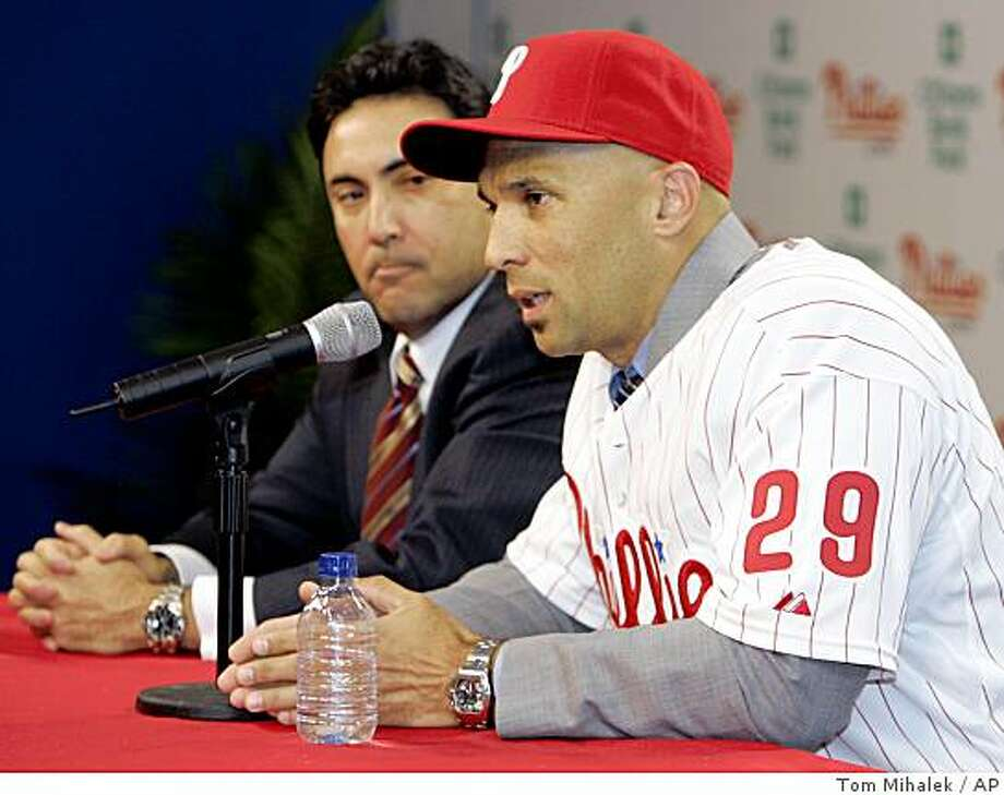 Philadelphia Phillies general manager Ruben Amaro Jr., left, listens as outfielder Raul Ibanez, right, answers a question during the news conference announcing that Ibanez has signed a three-year, $31.5 million contract with the baseball team Tuesday, Dec. 16, 2008, in Philadelphia. Photo: Tom Mihalek, AP