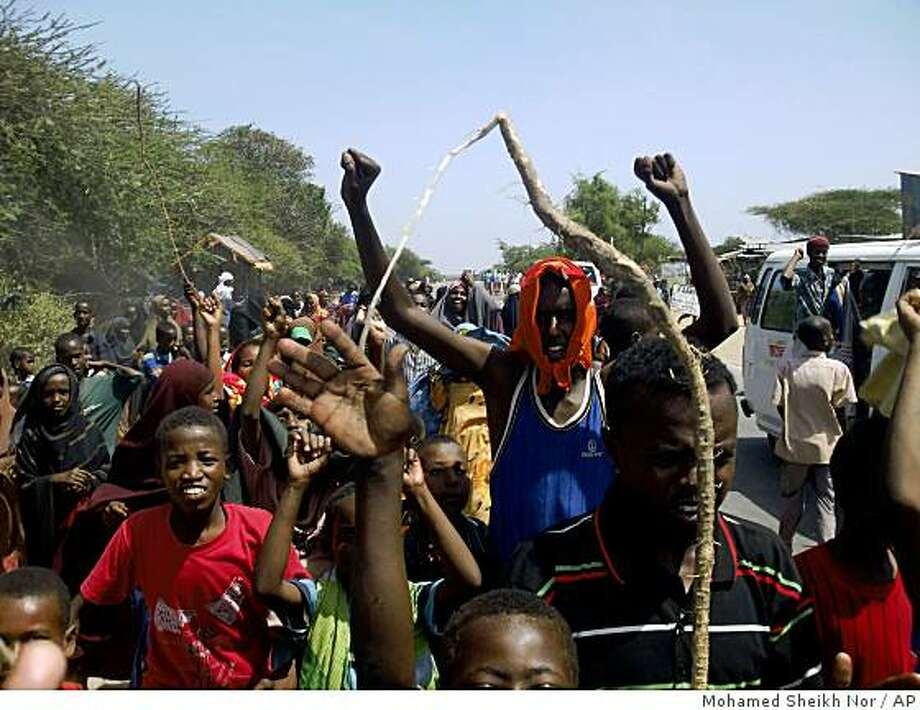 Residents on the outskirts of Mogadishu take to the streets to protest against the newly appointed prime minister Mohamed Mohamud Guled  Tuesday Dec.16, 2008. Somalia's president announced Tuesday the nomination of a new prime minister for the country's embattled transitional government a day after the Somali parliament overwhelmingly backed the government of Prime Minister Nur Hassan Hussein. (AP Photo/ Mohamed Sheikh Nor) Photo: Mohamed Sheikh Nor, AP