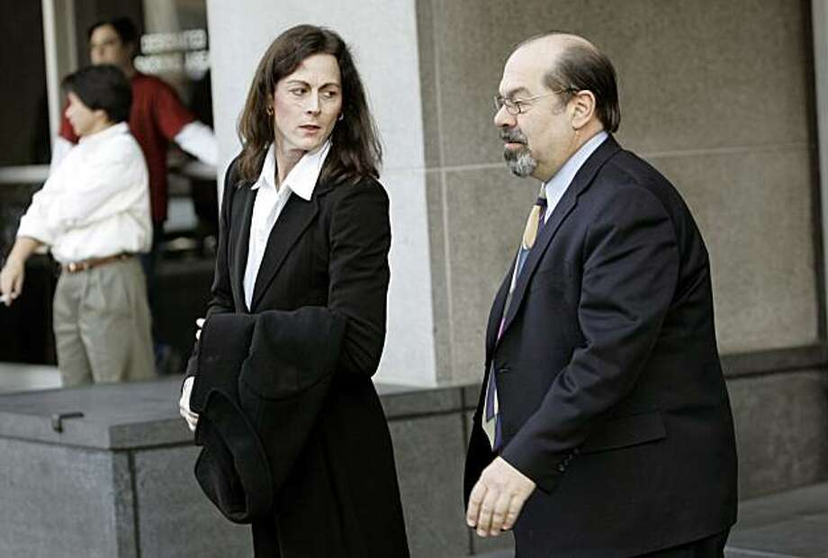 **ADVANCE FOR MONDAY, MARCH 24 - FILE ** Former Olympic cyclist Tammy Thomas, left, leaves the federal courthouse with her attorney, Tony Tamburello, in San Francisco, in this file photo from Jan. 19, 2007. Thomas's perjury trial begins Monday, March 24, 2008, with jury selection and is expected to last about two weeks.  (AP Photo/Jeff Chiu, file) Photo: Jeff Chiu, AP
