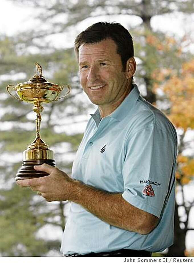 European Ryder Cup team captain Nick Faldo poses with the Ryder Cup trophy at the site of the 2008 Ryder Cup Championship at Valhalla Golf Club in Louisville, Kentucky October 22, 2007. REUTERS/ John Sommers II (UNITED STATES) Ran on: 10-28-2007 Nick Faldo accumulated more points than any other Ryder Cup player. Now he's a captain. Photo: John Sommers II, Reuters