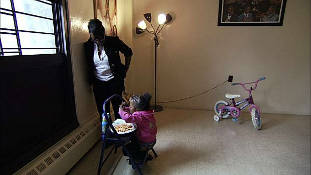 Nadiyah Horne watches her daughter, Ameenah, say grace in a scene from,