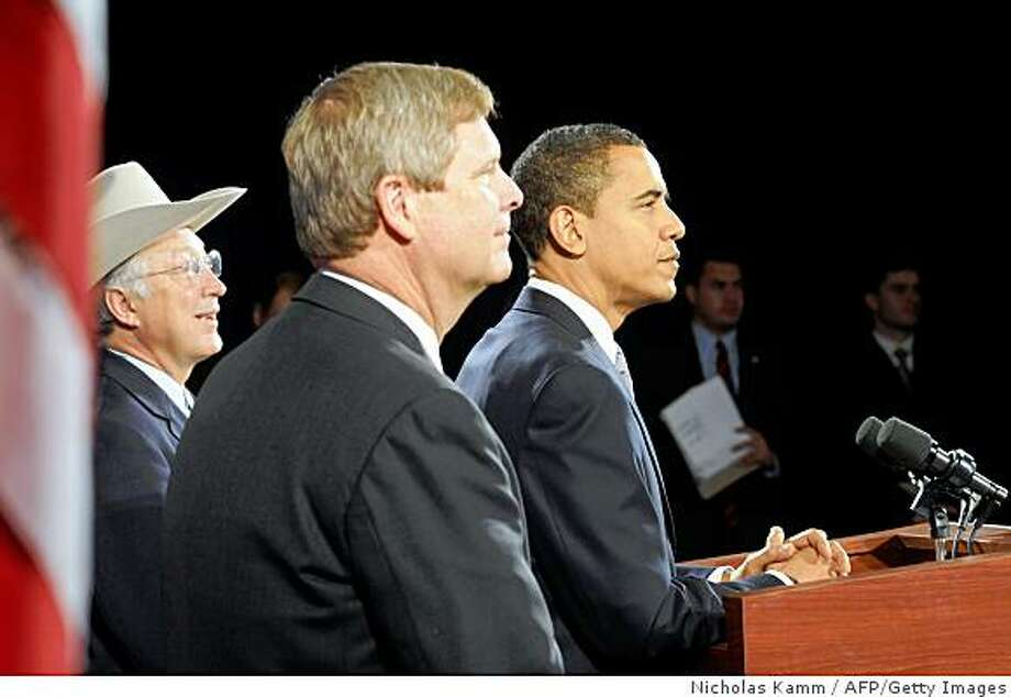 "US president-elect Barack Obama gives a press conference to announce his pick as agriculture secretary Tom Vilsack (C)and Ken Salazar (L) as interior secretary in Chicago on December 17, 2008. Together they will serve as guardians of the American landscape on which the health of our economy and the wellbeing of our families so heavily depends,"" Obama told a news conference. AFP PHOTO/Nicholas KAMM (Photo credit should read NICHOLAS KAMM/AFP/Getty Images) Photo: Nicholas Kamm, AFP/Getty Images"
