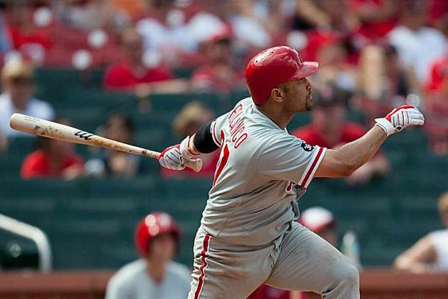 ST. LOUIS - JULY 22: Placido Polanco #27 of the Philadelphia Phillies watches his game-winning home run leave the park against the St. Louis Cardinals at Busch Stadium on July 22, 2010 in St. Louis, Missouri. The Phillies defeated the Cardinals 2-0. Photo: Dilip Vishwanat, Getty Images