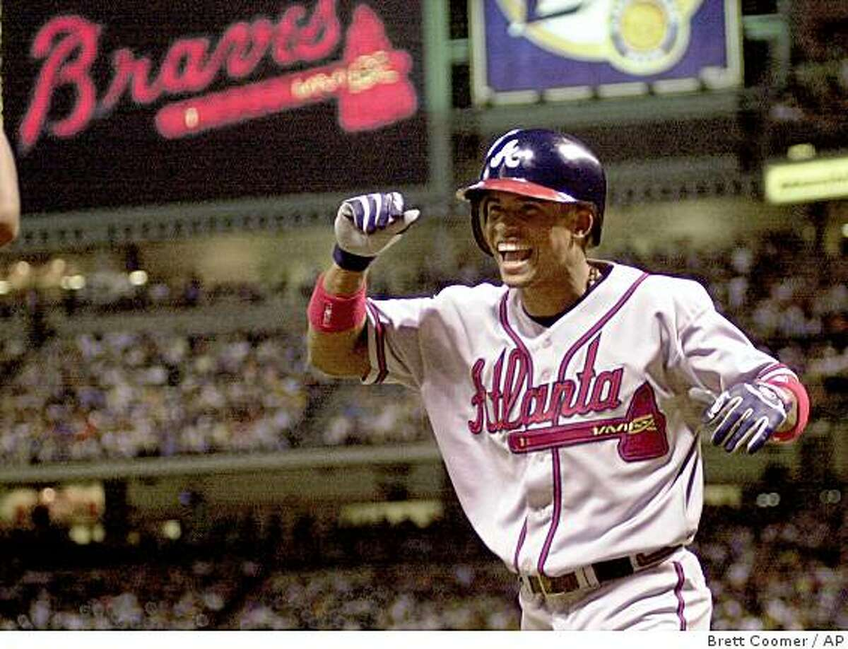 ** FILE ** This Sept. 2, 2000 file photo shows Atlanta Braves' Rafael Furcal reacts after hitting his first major league home run during the ninth inning against the Houston Astros, in Houston. Furcal is close to accepting a $30 million, three-year offer to return to the Atlanta Braves. The 31-year-old began his major league career with Atlanta, playing for the Braves from 2000-05. He spent the last three seasons with the Los Angeles Dodgers. (AP Photo/Brett Coomer, File)