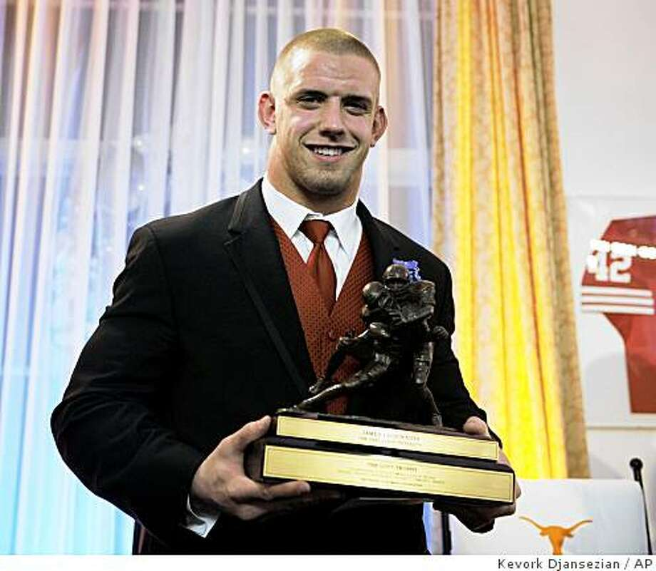 Ohio State linebacker James Laurinaitis poses with the The Lott Trophy named after NFL great Ronnie Lott at the Pacific Club in Newport Beach, Calif., Sunday, Dec. 14, 2008. Photo: Kevork Djansezian, AP