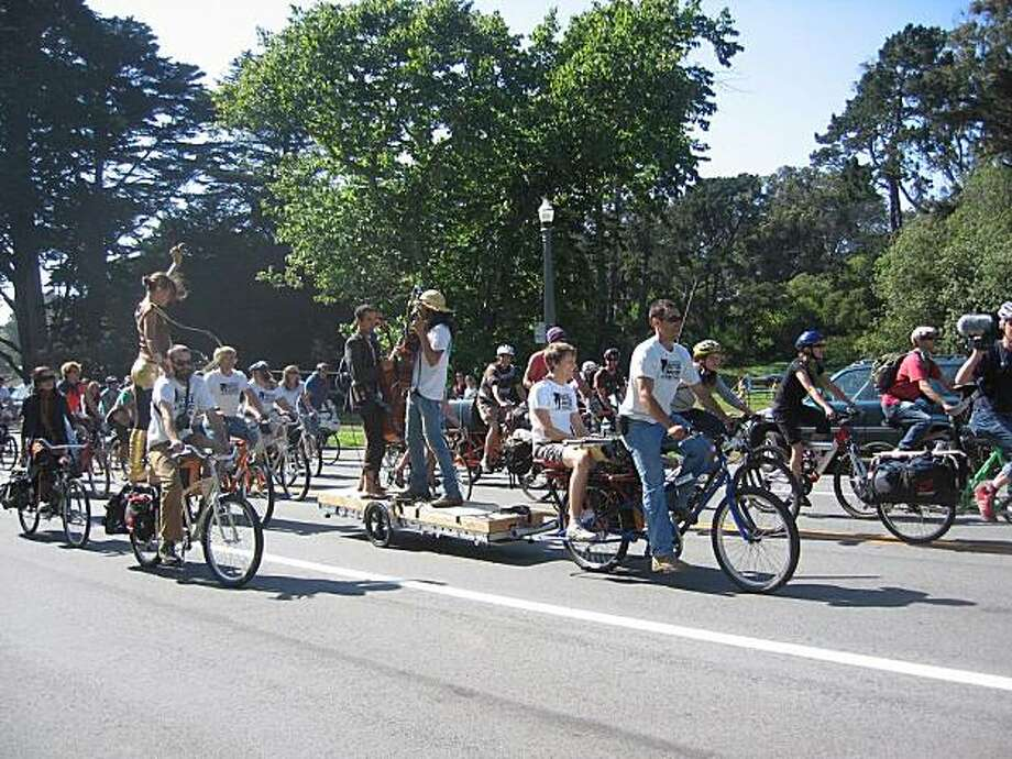 Cello Joe performs during the LiveOnBike bicycle parade during the 2009 Bicycle Music Festival. Photo: Janet DeHaven 2009