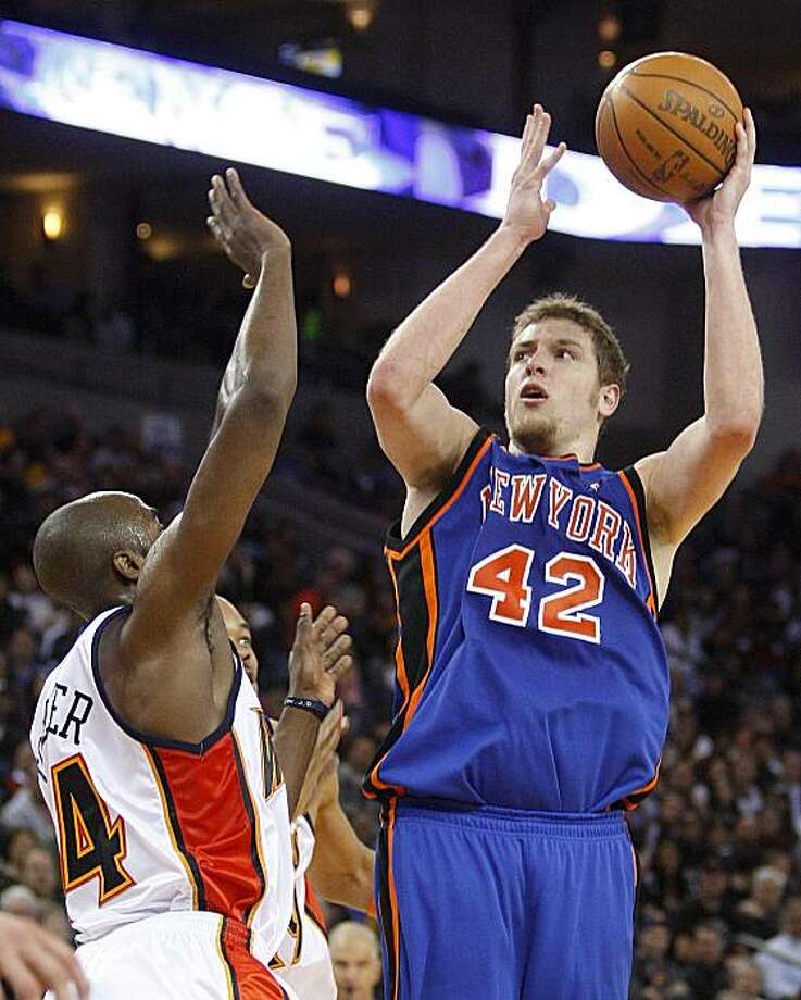 in this April 2, 2010, file photo, New York Knicks' David Lee, right, shoots over Golden State Warriors' Anthony Tolliver during the second half of an NBA basketball game in Oakland, Calif. Lee is headed from the New York Knicks to the Golden StateWarriors in a sign-and-trade deal, the All-Star forward's agent said Thursday. Photo: Ben Margot, AP