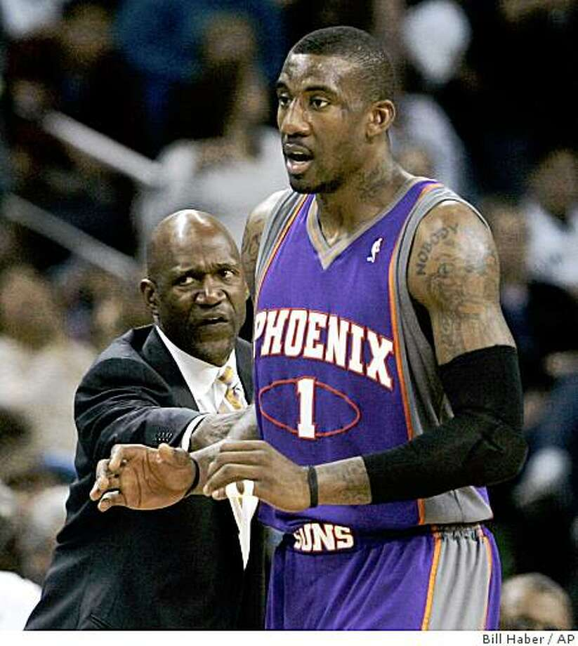 Phoenix Suns center Amare Stoudemire (1) is held back by coach Terry Porter as he protests a foul call, during the second half against the New Orleans Hornets in an NBA basketball game in New Orleans, Wednesday, Dec. 3, 2008.  The Hornets defeated the Suns 104-91. (AP Photo/Bill Haber) Photo: Bill Haber, AP