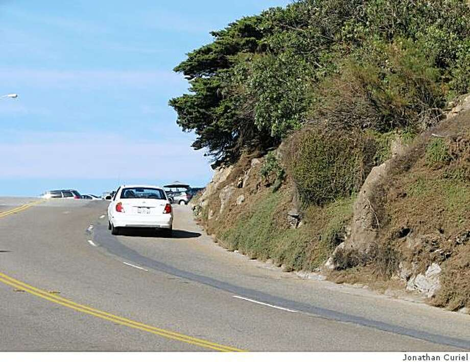 The shrubs on the hillside that faces the Cliff House were growing into Point Lobos Avenue, the road that goes past the Cliff House. Photo: Jonathan Curiel