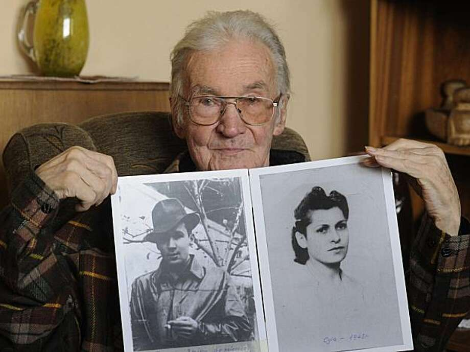 In this May 11, 2010 photo Jerzy Bielecki is seen presenting photos of him in 1944, left, and Cyla in 1945, in his home in Nowy Targ, southern Poland. 66 years ago Bielecki, then an Auschwitz Birkenau prisoner, escaped from the death camp with his Jewish girlfriend, Cyla Cybulska. Photo: Alik Keplicz, AP