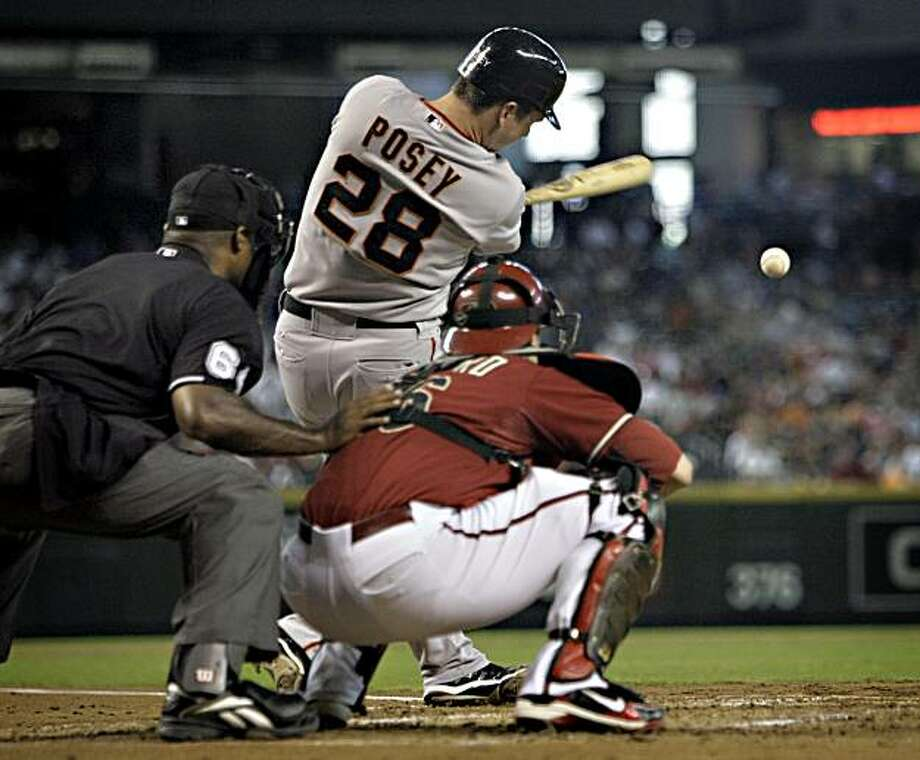 San Francisco Giants' Buster Posey (28) connects for his second hit of the baseball game against the Arizona Diamondbacks during the second inning on Sunday, July 25, 2010, in Phoenix. Photo: Matt York, AP