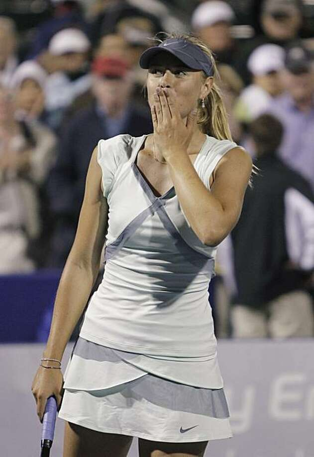 Maria Sharapova, from Russia, blows kisses to the crowd after defeating Zheng Jie, from China, 6-4, 7-5 in the Bank of the West Classic tennis tournament in Stanford, Calif., Tuesday, July 27, 2010. Photo: Paul Sakuma, AP