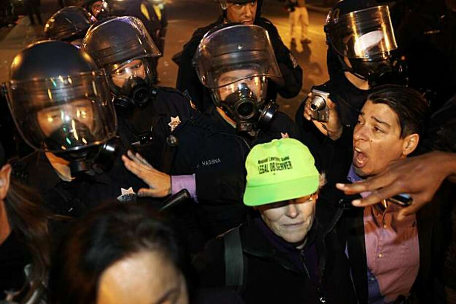 Oakland Councilmember at large, Rebecca Kaplan, right, tries to dissuade riot police from advancing on protesters at the intersection of 14th Street and Broadway. Reaction after the verdict in the Johannes Mehserle trial is announced on Thursday, July 8, 2010. Mehserle was convicted of involuntary manslaughter in the shooting of Oscar Grant at the Fruitvale BART station on January 1, 2009. Photo: Carlos Avila Gonzalez, The Chronicle