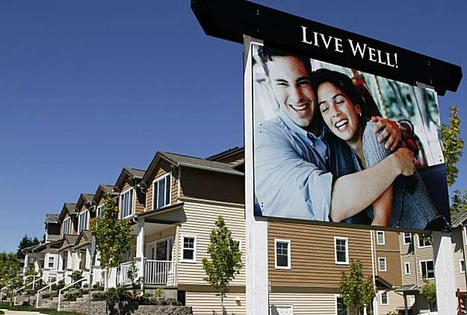 New townhouses for sale are shown in Beaverton, Ore., Monday, July 26, 2010.  The Commerce Deptartment says sales of new homes increased to an annual rate of 330,000 units in June with the gain coming after sales hit a new low in May. Photo:  Don Ryan, AP