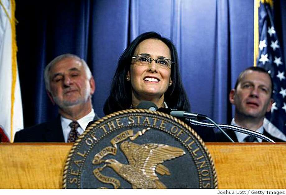 CHICAGO - DECEMBER 12:  Illinois Attorney General Lisa Madigan (C) speaks about Illinois Governor Rod Blagojevich during a press conference at The Thompson Center  December 12, 2008 in Chicago, Illinois. Madigan has asked the Illinois Supreme Court to declare Blagojevich unfit as governor after he was arrested on December 9 by FBI Agents and charged with attempting to sell the U.S. Senate seat vacated by U.S. President-elect Barack Obama for money and favors.  (Photo by Joshua Lott/Getty Images) Photo: Joshua Lott, Getty Images