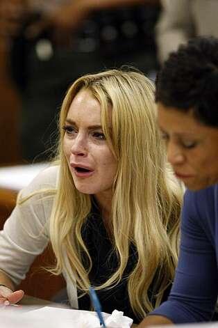 Blonde Lindsay Lohan looking upset in court