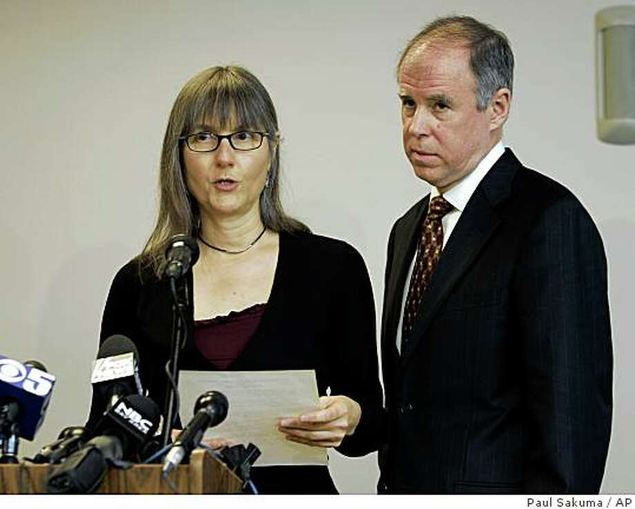 Marilyn Walker, left, and Frank Lindh, right, reads a statement during a news conference in San Francisco, Wednesday, Dec. 17, 2008. Both parents of American-born Taliban fighter John Walker Lindh are asking President Bush to set their son free before the president leaves office next month. Lindh was sentenced to 20 years in prison after pleading guilty in 2002 to serving in the Taliban army, which violated U.S. economic sanctions against Afghanistan at that time. (AP Photo/Paul Sakuma) Photo: Paul Sakuma, AP