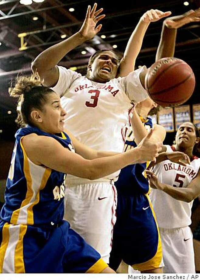 Oklahoma's Courtney Paris (3) fights for a rebound against California State Bakersfield's Christine Kepenekian, left, in the first half of an NCAA college basketball game in San Jose, Calif., Friday, Dec. 12, 2008. (AP Photo/Marcio Jose Sanchez) Photo: Marcio Jose Sanchez, AP