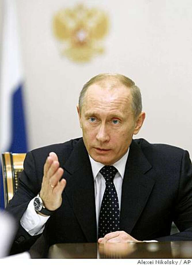 Russian Prime Minister Vladimir Putin gestures while speaking at a meeting in Moscow, Wednesday, Dec. 17, 2008. (AP Photo/RIA-Novosti, Alexei Nikolsky, Pool) Photo: Alexei Nikolsky, AP