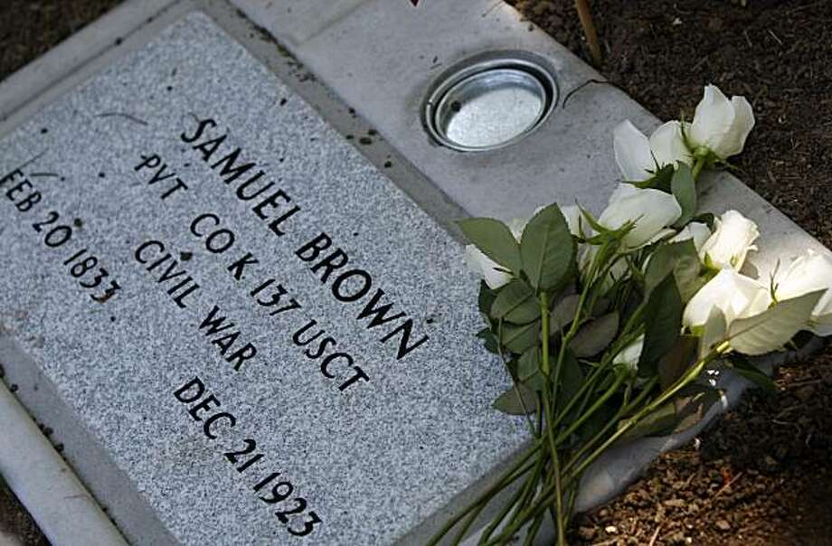 "Roses were placed on a new gravestone for Samuel Brown at Sunrise Memorial Cemetery in Vallejo on Saturday. Brown was an ex-slave who served as a soldier for the Union during the Civil War, but his grave marker wrongly stated his service in the ""Confederate States Army"" until a cemetery worker noticed the error. Photo: Paul Chinn, The Chronicle"