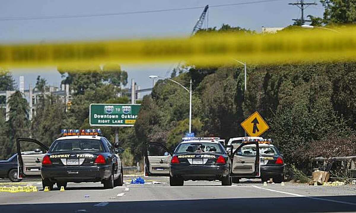 Interstate 580 in Oakland was closed in both directions Sunday after a shootout Saturday night involving two CHP officers and a man wearing body armor.