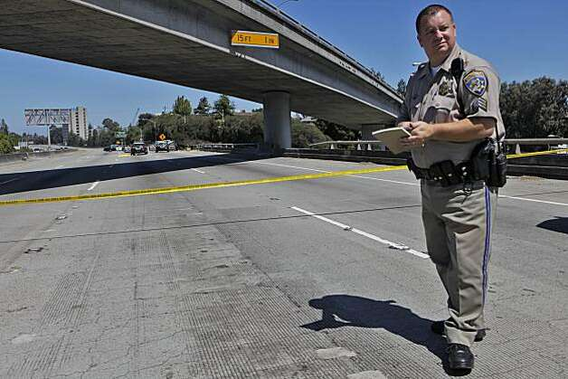 California Highway Patrol Sgt. Jason Roy patrols the scene of an officer involved shooting on I-580 in Oakland on Sunday. Photo: Lacy Atkins, The Chronicle