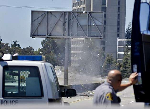 Alameda County Sheriff Don Garcia watches as the Alameda County Bomb Squad detonates two suspicious items taken from a white Toyota's trunk on Sunday on I-580 in Oakland. Photo: Lacy Atkins, The Chronicle
