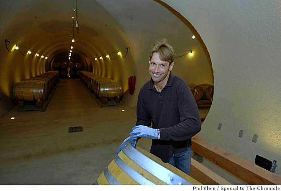 Winemaker Nick DeLuca rolls a wine barrel inside the newly built underground wine cellar at the Star Lane vineyard in Santa Ynez on Tuesday, Dec. 9, 2008. Photo/Phil Klein Photo: Phil Klein, Special To The Chronicle