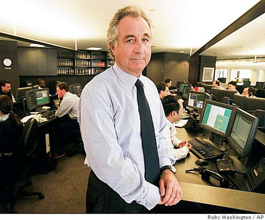 """Bernard L. Madoff, chairman of Madoff Investment Securities is seen on his Manhattan trading floor in this photo taken Dec. 30, 1999 in New York. The former Nasdaq stock market chairman was arrested on a securities fraud charge Thursday, Dec. 11, 2008, accused of running a phony investment business that lost at least $50 billion and amounted to nothing more than a """"giant Ponzi scheme.""""  (AP Photo/The New York Times, Ruby Washington)  ** MANDATORY CREDIT, NYC OUT, MAGS OUT, NO SALES, TV OUT, NO ARCHIVE ** Photo: Ruby Washington, AP"""