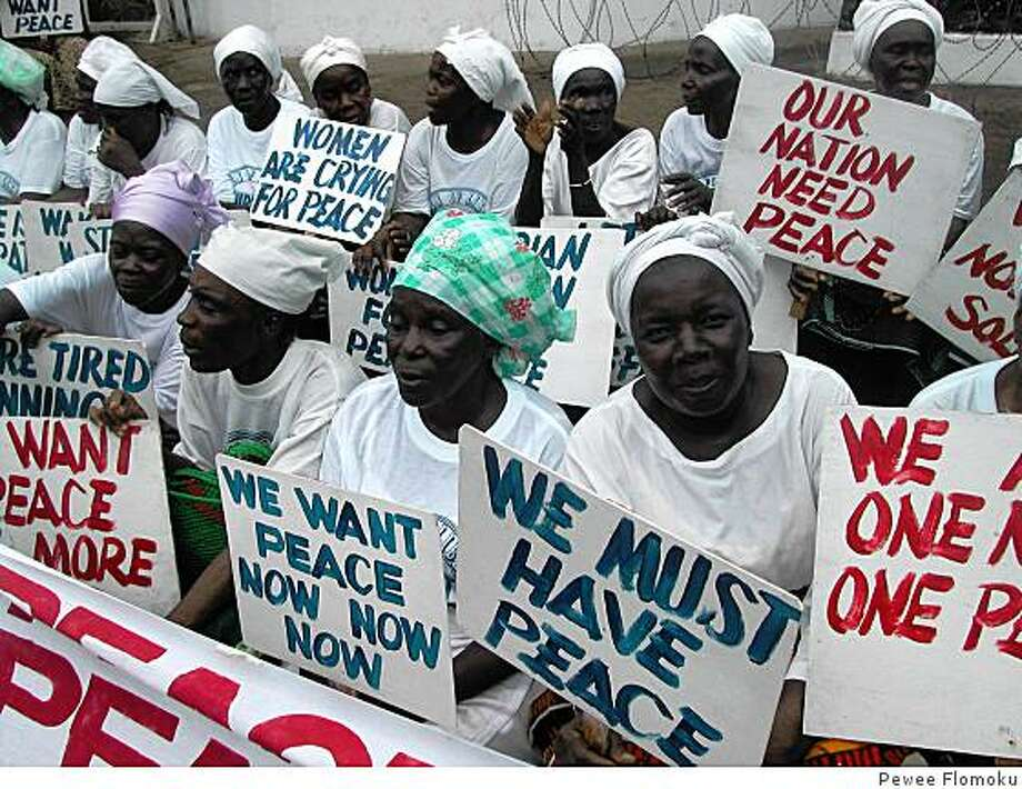 "Liberian women demonstrate at the American Embassy in Monrovia at the height of the civil war in July 2003. From the movie ""Pray the Devil Back to Hell."" Photo: Pewee Flomoku"