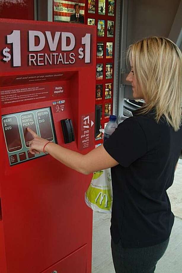 A customer uses a Redbox Automated Retail LLC kiosk at at McDonald's in this company handout photo dated March 19, 2007. McDonald's Corp.'s $1 menu offers more than burgers, chicken nuggets and fries. Diners can now rent hot DVDs such as ``Shrek 3'' fromautomated kiosks for a buck, $3 cheaper than at Blockbuster Inc. stores. Source: RedBox via Bloomberg News Photo: Via Bloomberg News