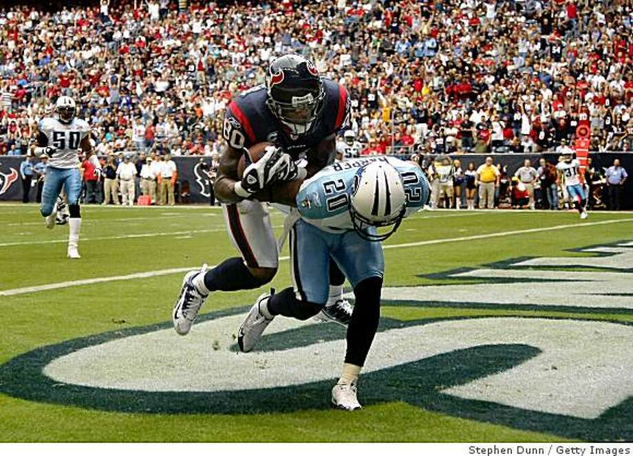 HOUSTON - DECEMBER 14:  Wider receiver Andre Johnson #80 of the Houston Texans makes a touchdown catch over cornerback Nick Harper #20 of the Tennessee Titans on December 14, 2008 at Reliant Stadium in Houston, Texas.  (Photo by Stephen Dunn/Getty Images) Photo: Stephen Dunn, Getty Images