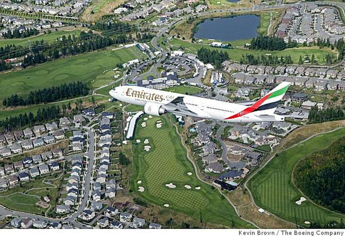 Boeing and Emirates took advantage of an upcoming delivery of a 777-200LR (Longer-Range) with a dramatic flyover of the TPC Snoqualmie Ridge golf club in Snoqualmie, Washington, on Friday, Aug. 25. Emirates Airlines 777-300ER of Snoqualmie Ridge Golf CourseK64539