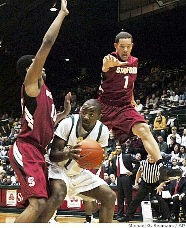Colorado State's Travis Franklin, center, fakes out Stanford's Mitch Johnson, right, as Stanford's Lawrence Hill, left, holds his ground in the first half of an NCAA college basketball game in Fort Collins, Colo., on Sunday, Dec. 14, 2008. Stanford won 74-63. (AP Photo/Fort Collins Coloradoan, Michael G. Seamans) ** MANDATORY CREDIT ** Photo: Michael G. Seamans, AP