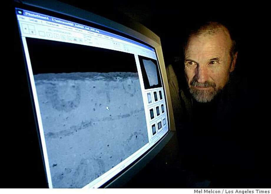 CAMERA: Ken Boydston, president of Megavision, looks at a line of text on a shard of pottery about 3,000 years old. His company specializes in creating high-resolution images to assist scholars and collectors. Illustrates CAMERA (category a) by Catherine Saillant (c) 2008, Los Angeles Times. Moved Thursday, Dec. 4, 2008. (MUST CREDIT: Los Angeles Times photo by Mel Melcon.) Ken Boydston, president of Megavision, looks at a line of text on a shard of pottery about 3,000 years old. His company specializes in creating high-resolution images to assist scholars and collectors. Illustrates CAMERA (category a) by Catherine Saillant (c) 2008, Los Angeles Times. Moved Thursday, Dec. 4, 2008. (MUST CREDIT: Los Angeles Times photo by Mel Melcon.) Photo: Mel Melcon, Los Angeles Times