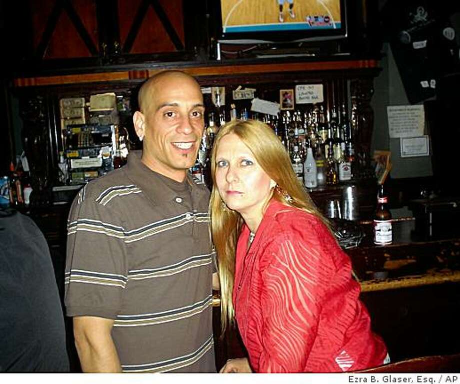 **RETRANSMITTING TO CORRECT FIRST SENTENCE REFERENCE TO GIULIANO'S STING OPERATION AGAINST ALLO NOT QUINN** This May 2008 photo provided by attorney Ezra B. Glaser shows his client, Doreen Giuliano, AKA Dee Quinn, and juror Jason Allo at a Brooklyn, New York bar, during  one of their last meetings in Giuliano's sting operation against Allo. What Allo, 33, thought was an innocent friendship with Giuliano, 47, in reality was an amateur sting operation by a desperate mother obsessed with saving her son from life behind bars. What Allo didn't know: Giuliano had undergone an extreme makeover - blonde dye job, fake tan, sexy wardrobe, phony name - to conceal her real identity and lure him into a trap that would expose his hidden misdeeds as a juror at her son's murder trial. The saga has become the basis for a defense motion filed this week demanding the verdict be set aside. (AP Photo/Ezra B. Glaser, Esq.) Photo: Ezra B. Glaser, Esq., AP