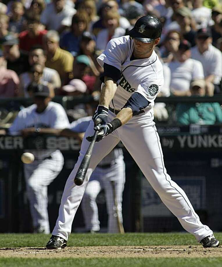 Seattle Mariners' Michael Saunders lines a two-run single against the Boston Red Sox in the eighth inning of a baseball game, Sunday, July 25, 2010, in Seattle. The Mariners beat the Red Sox, 4-2. Photo: Ted S. Warren, AP